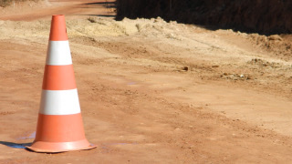 dirt-with-roadwork-cone